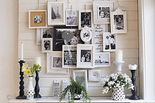 Spring mantel in black and white with a layered photo frame wall 1
