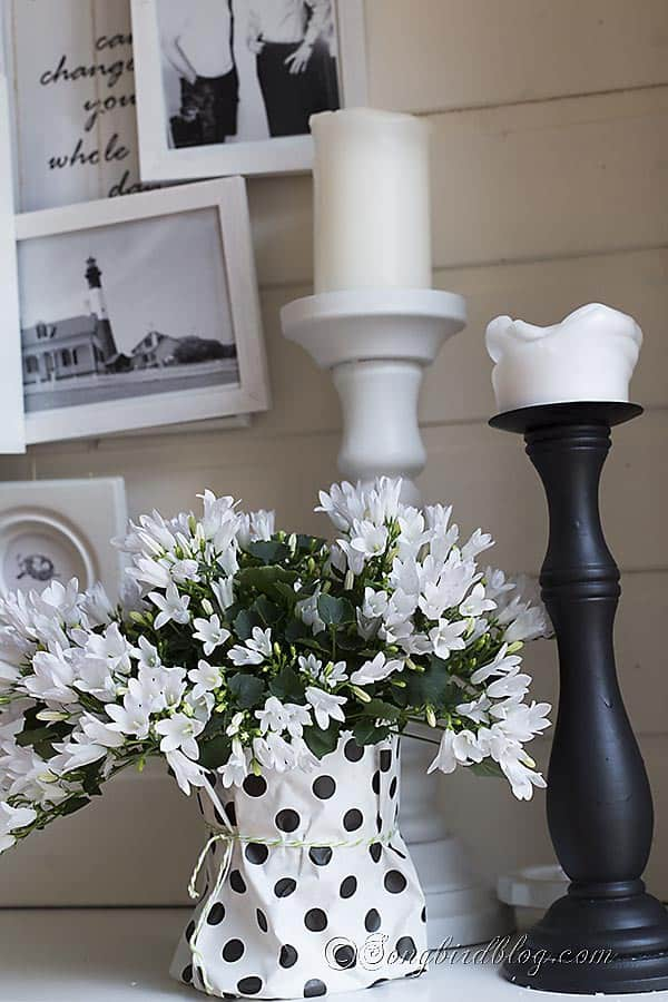 Spring mantel in black and white with a layered photo frame wall 2