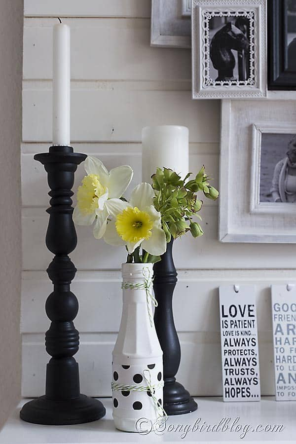 Spring mantel in black and white with a layered photo frame wall 5