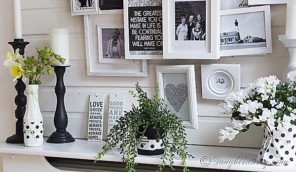 Spring mantel in black and white with a layered photo frame wall 8
