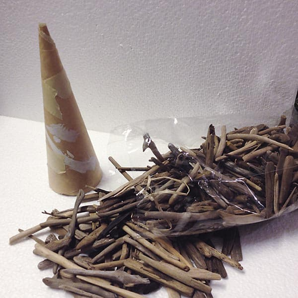Supplies for making a driftwood Christmas tree