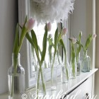 pink tulips in front of a mirror as mantel decoration for Spring