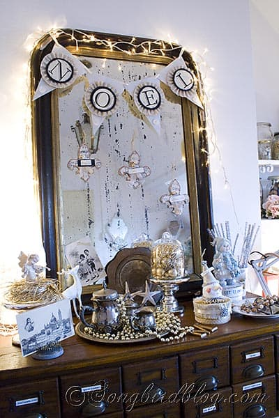 Christmas decorative display in front of vintage French mirror