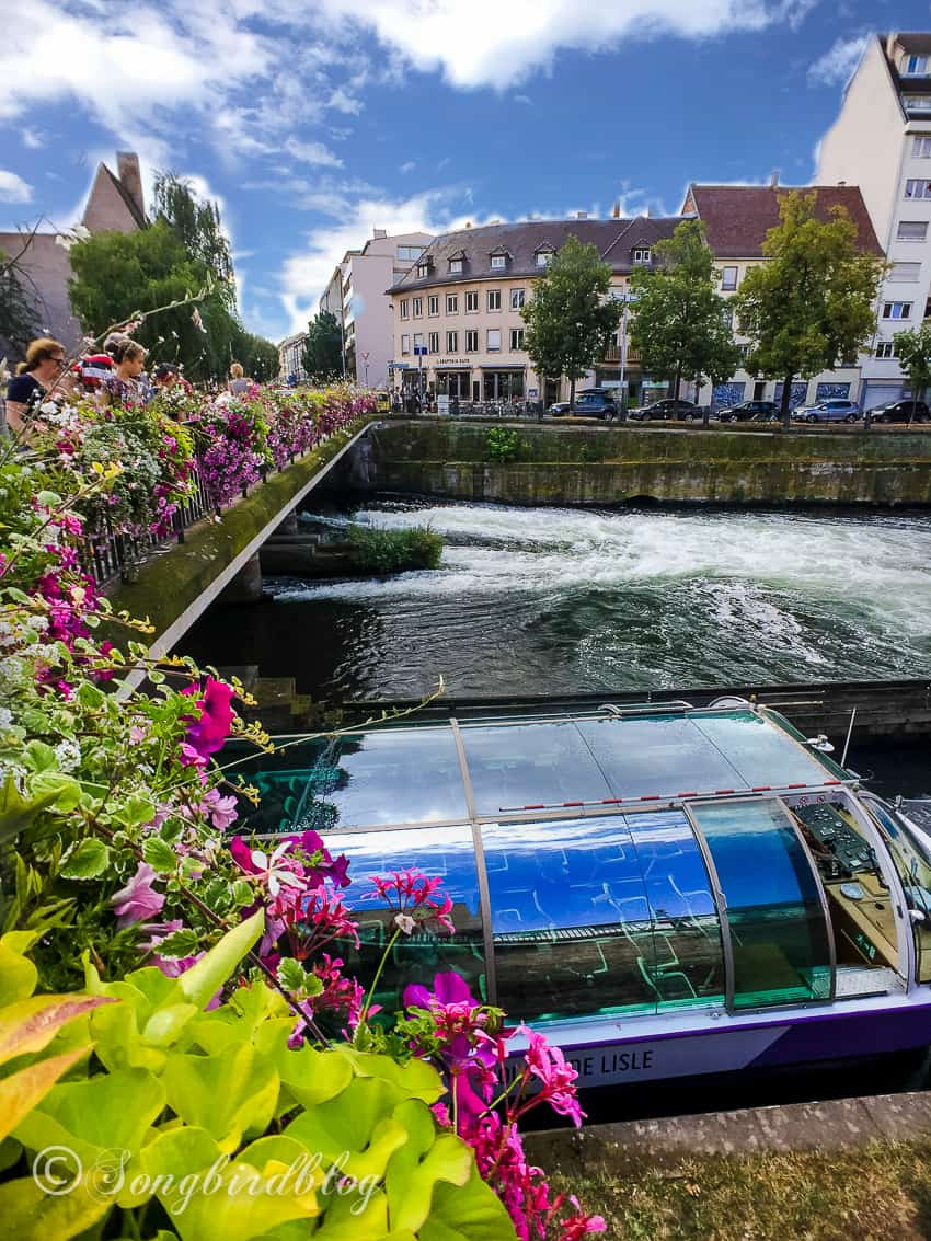 Strasbourg, France, bridge with boat passing