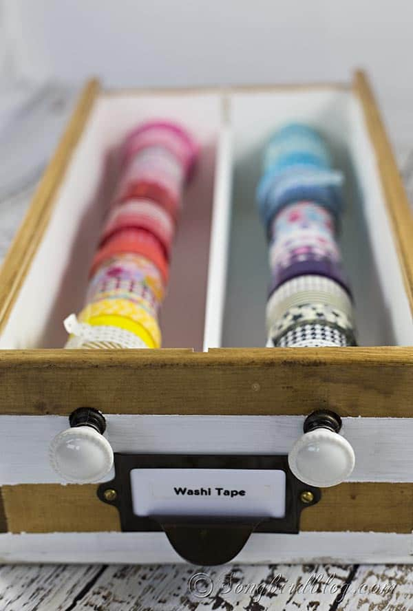 This washi tape organizer DIY project is perfect for your craft room. Repurpose a wooden wine box and create this easy and super useful washi tape storage.