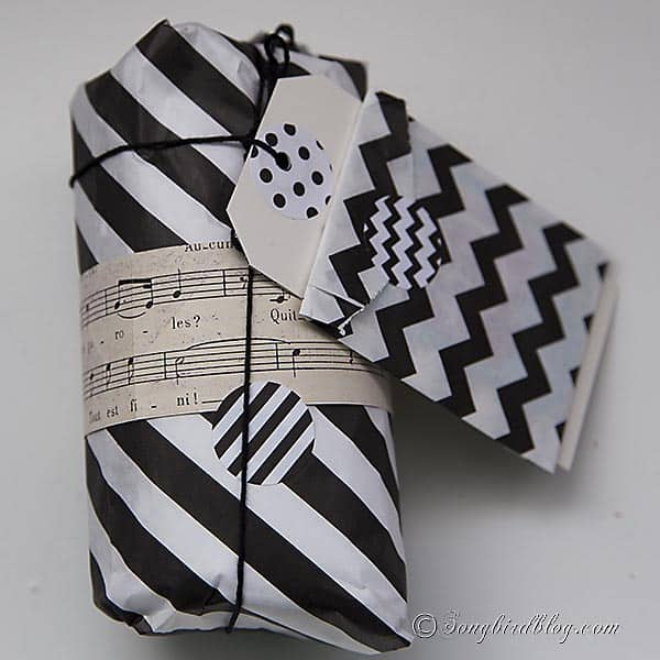 combine modern black and white gift wrap with vintage sheet music for an original gift wrapping. Songbirdblog.com