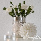 decoration with white flowers in tin can