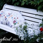 white wooden bench in garden