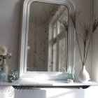 white mantel display with mirror