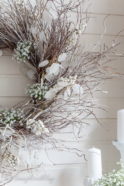Loving this white winter mantel with a touch of Spring. Focal point is a homemade twig wreath. It pairs beautifully with Spring flowers and mercury glass lanterns.