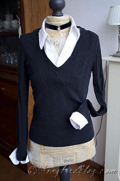 attach white collar and cuffs to a black sweater for a slim fitting look