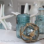 Decorating with blue mason jars and flowers