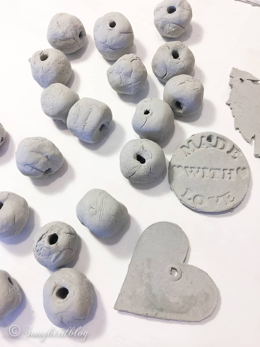 clay beads drying on white surface