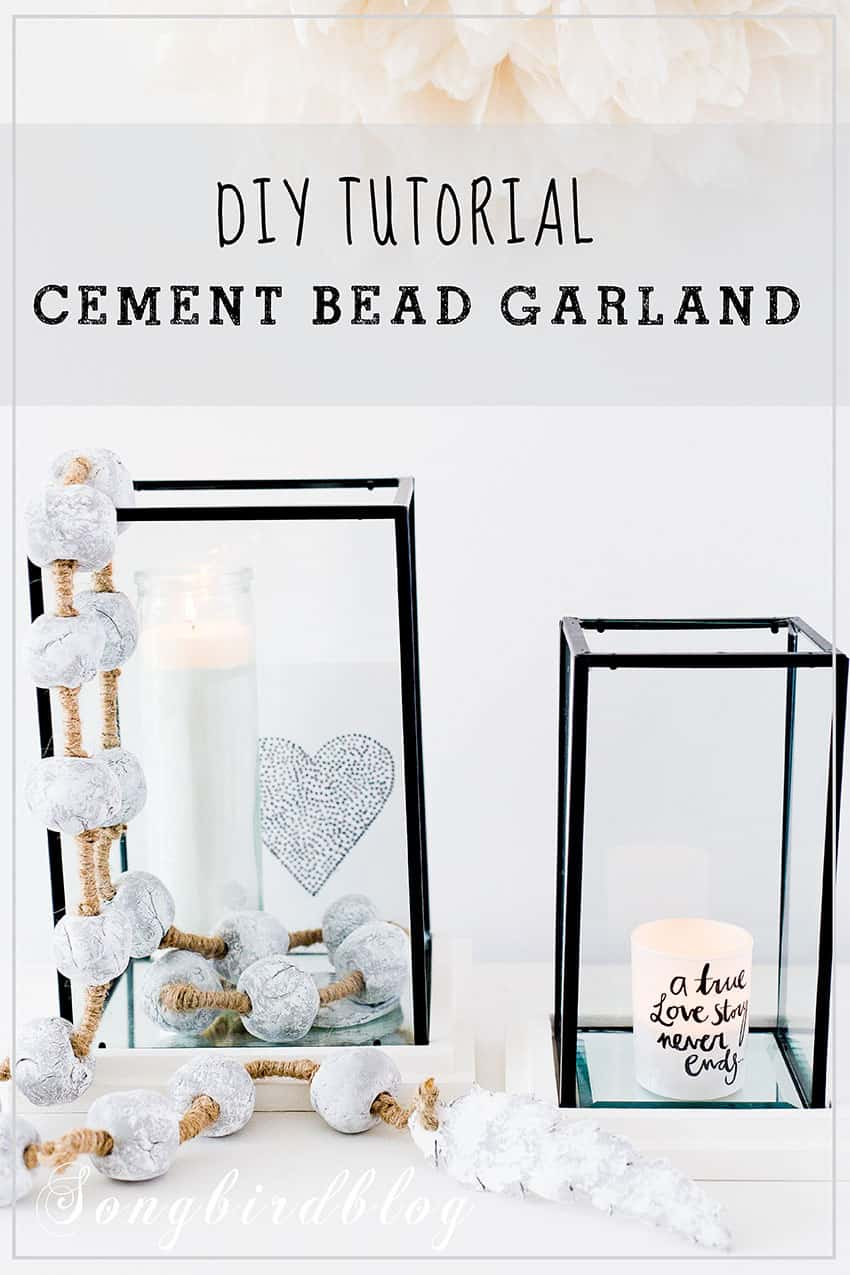 homemade cement bead garland decorations draped over glass hurricane candle holders