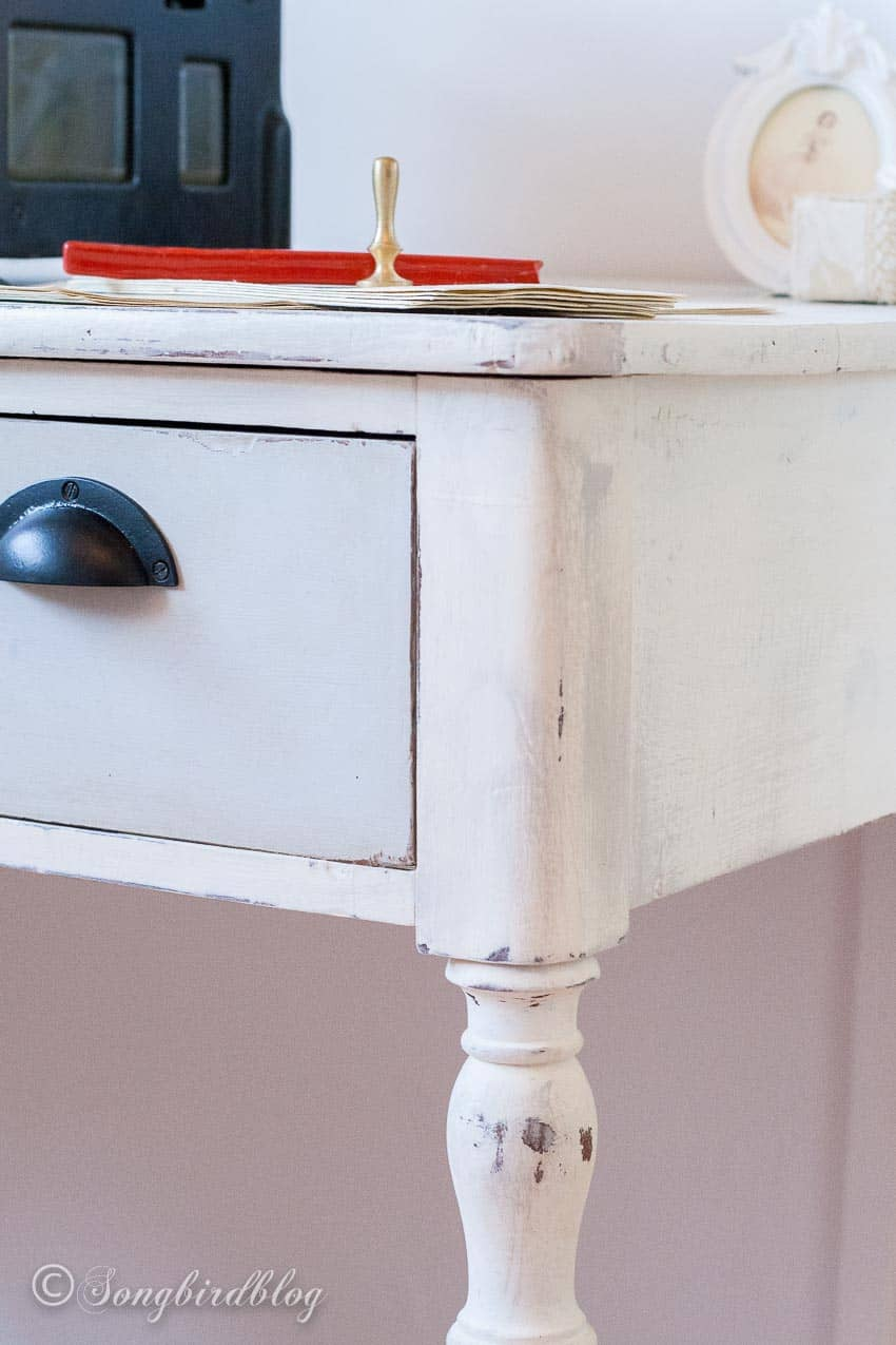 corner of white and grey desk painted with chalk paint