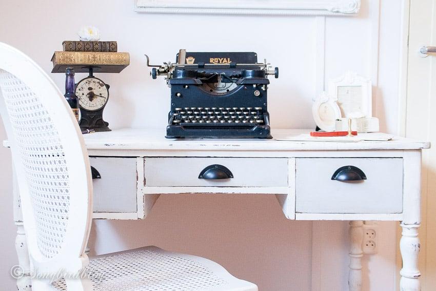Antique desk with vintage typewriter.