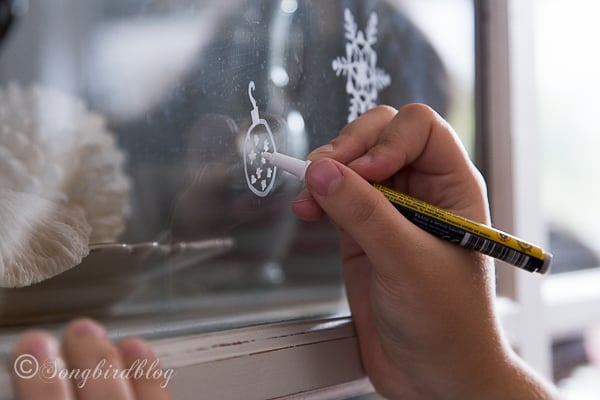 decorating Christmas windows with chalk pens