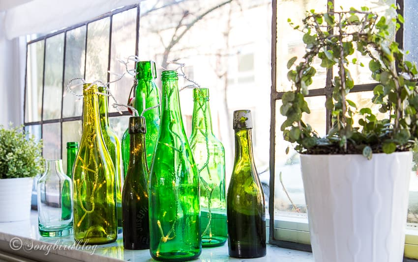 green bottles on a window sill