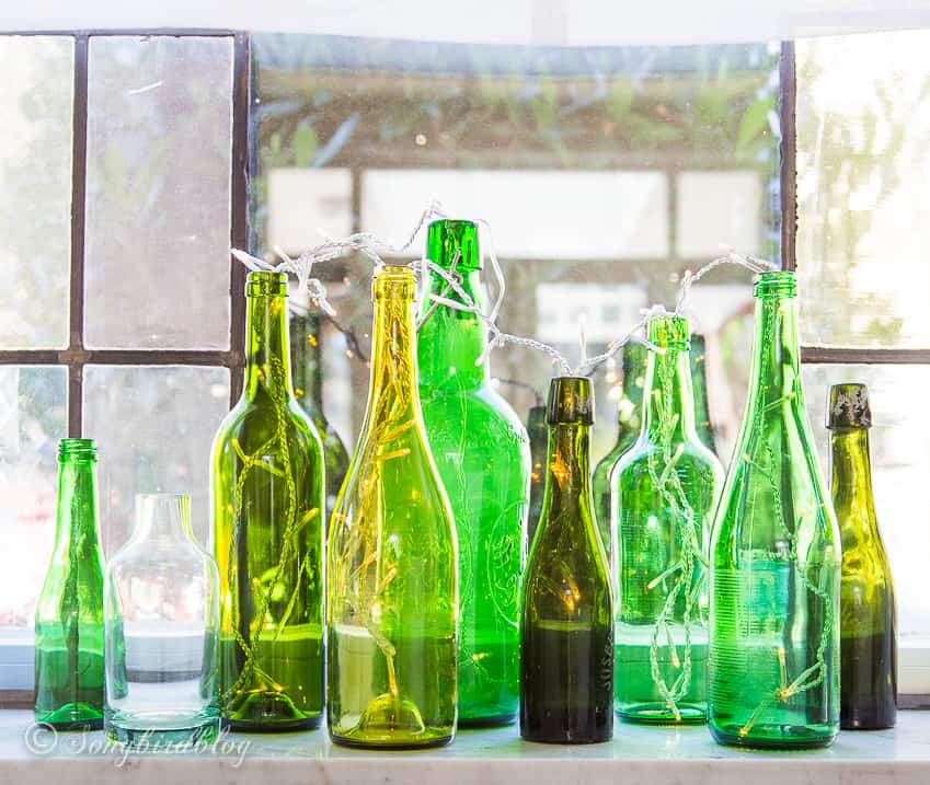 green bottles on window sill decor