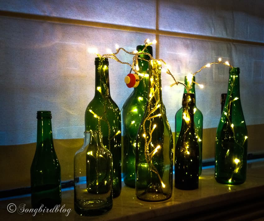 bottles with string of lights nighttime