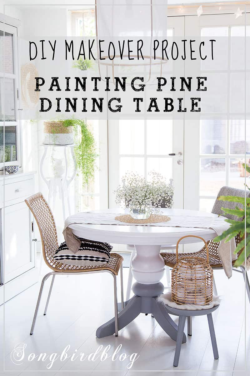 white dining room with painted table