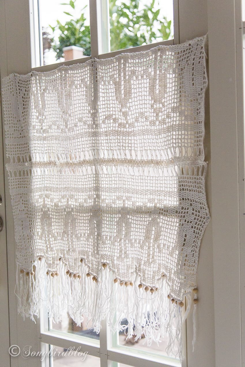 crochet curtain in front of window