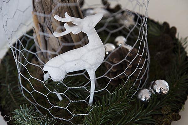 driftwood Christmas tree with deer under chicken wire cloche Christmas decoration http://www.songbirdblog.com