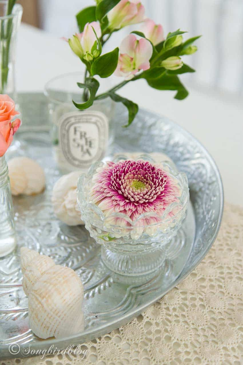 Single flowers in small vases floral arranging