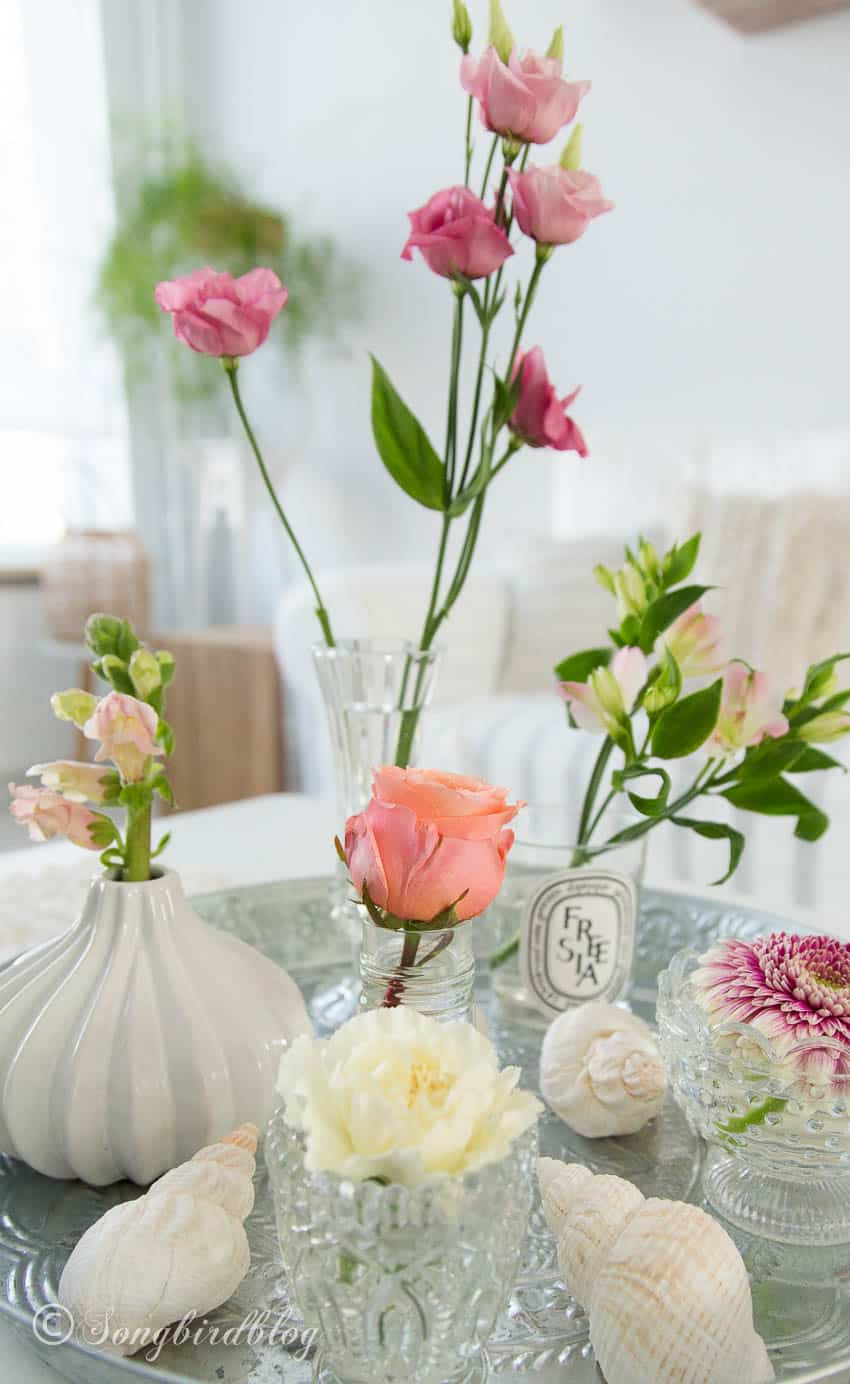 Single flowers, tiny vases floral arranging idea