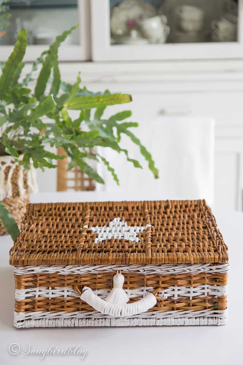 nautical basket with painted stripes and star on white table