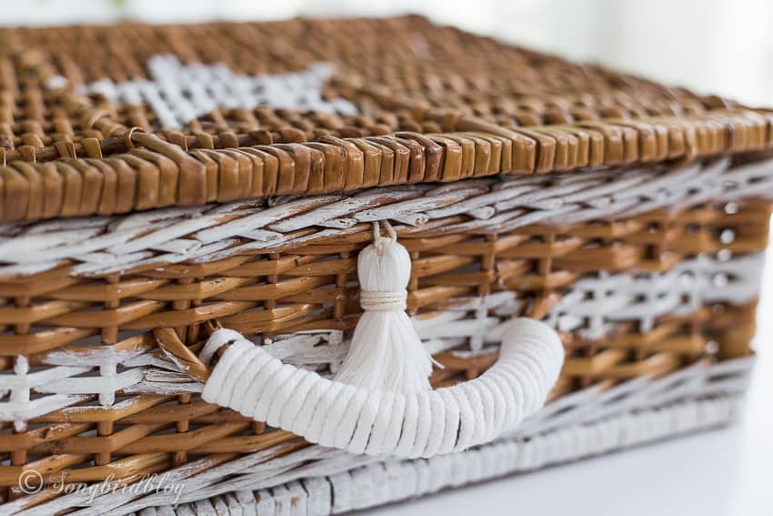 basket with painted strips and nautical details