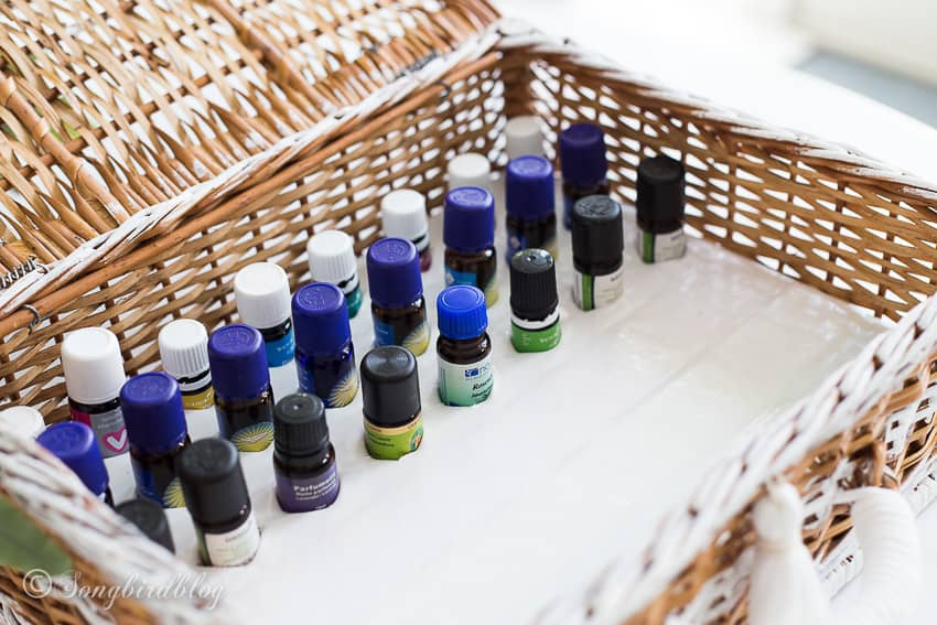 essential oils inside storage basket