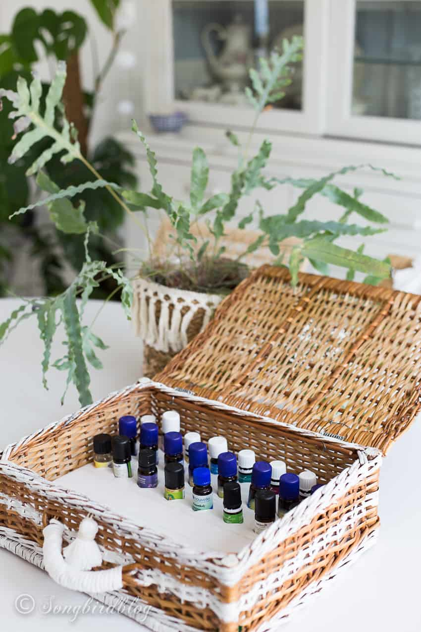 essential oils organized inside a storage basket