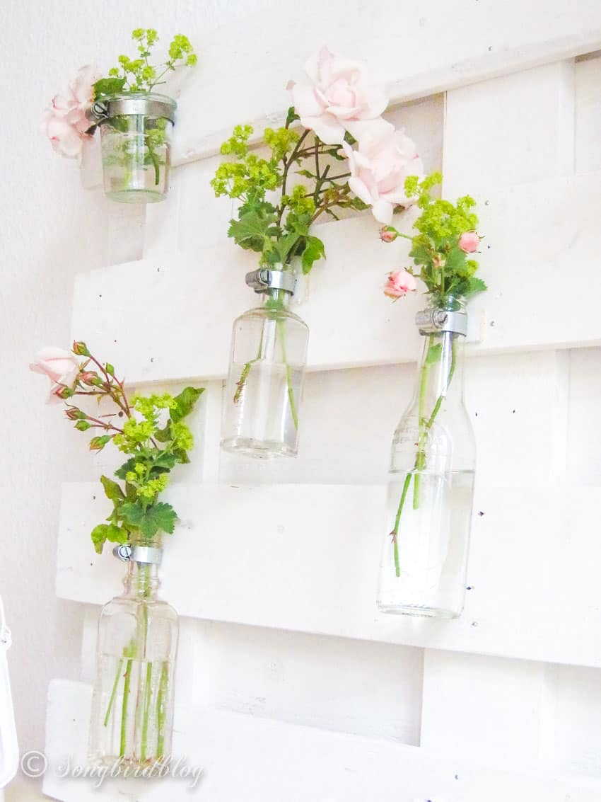 small glass bottles with soft pink roses