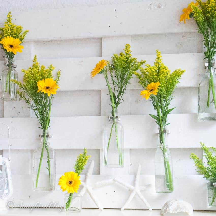 pallet wood mantel with yellow flowers