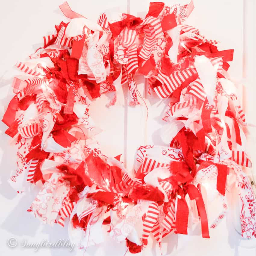 Fabric rag wreath made from white and red fabric scraps