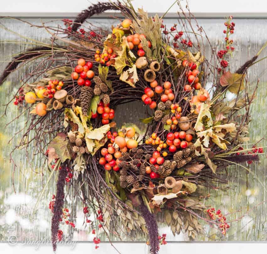 fall wreath orange berries on front door