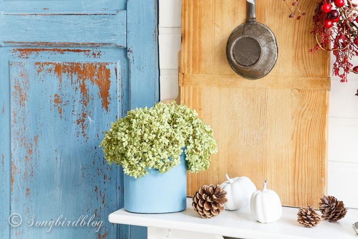farmhouse Fall mantel decor with vintage kitchen bread boards