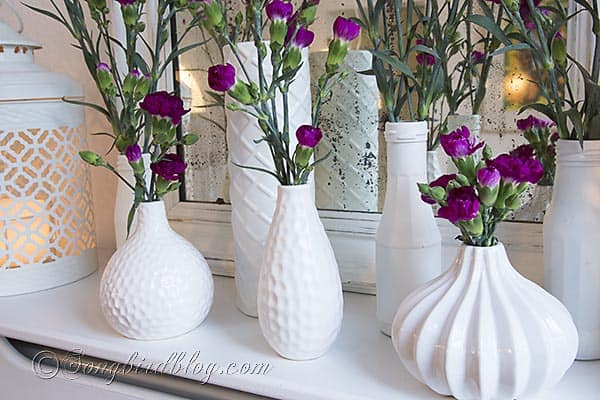 white vases pink flowers via Songbirdblog