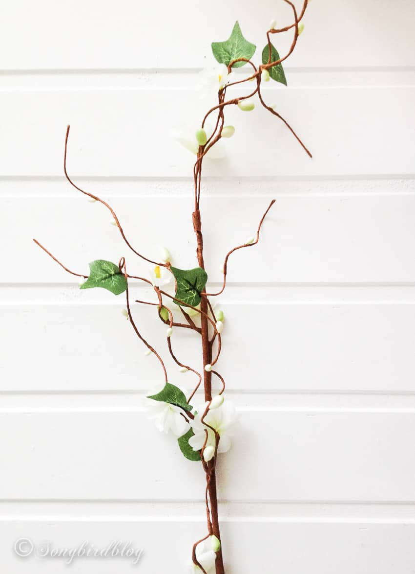 silk flowers on a brown stem