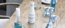 blue and white table decor with polka dot bottles