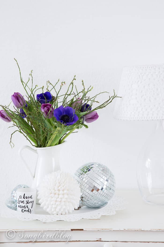 white decor with colorful flowers and disco balls