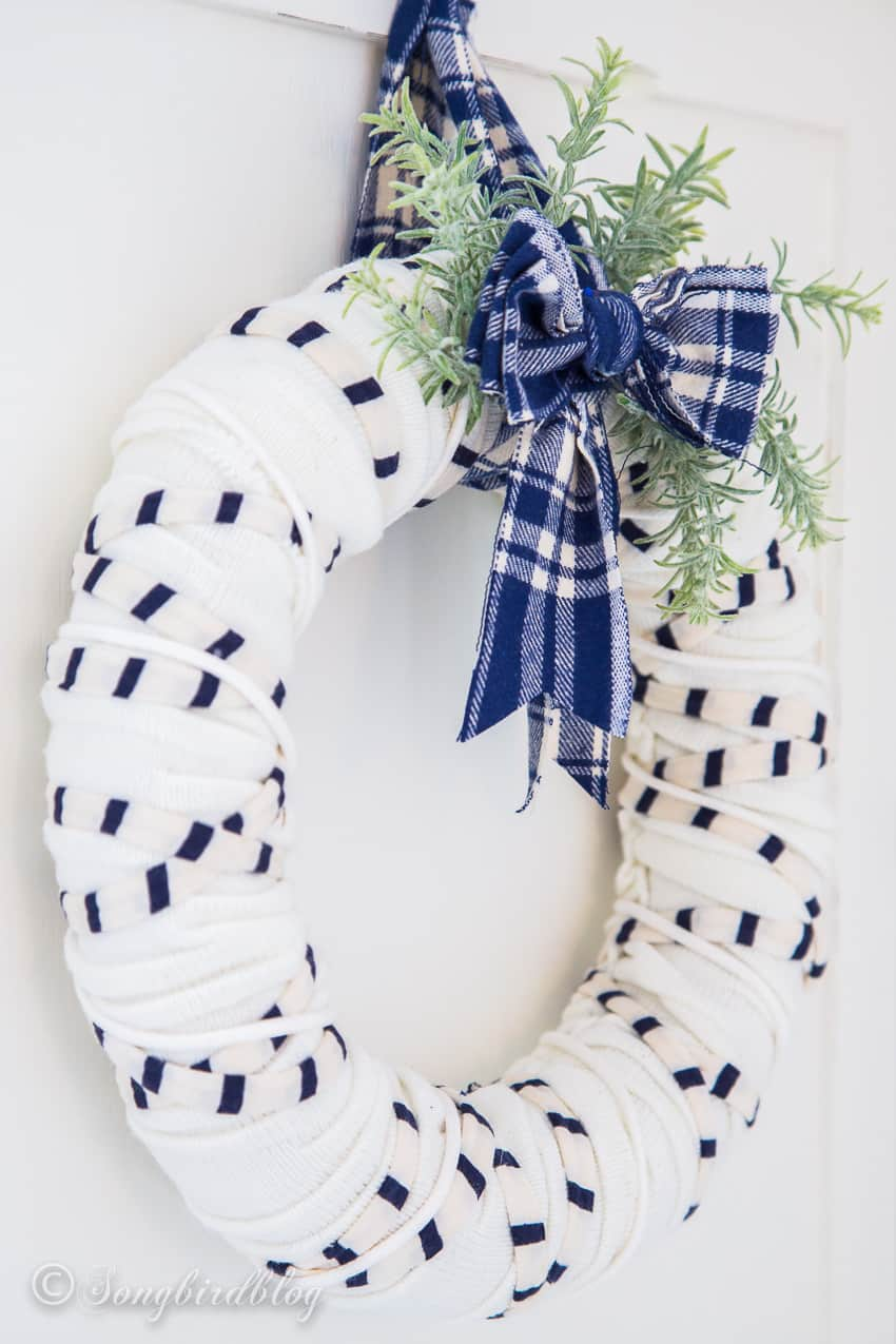 sideview of white winter scarf wreath