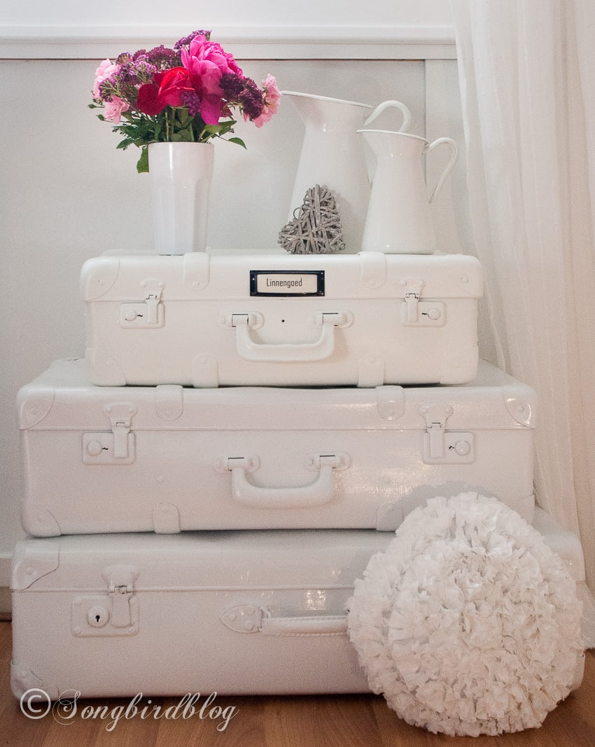 how to paint suitcases tips and tricks. Stacked white painted suitcases