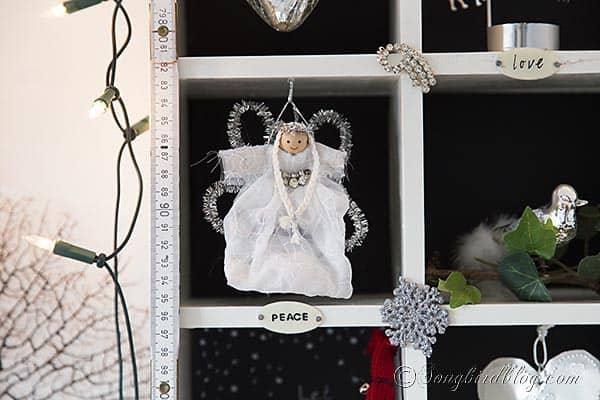handmade Christmas angel in a vintage Christmas display http://www.songbirdblog.com