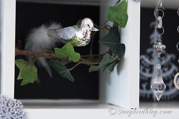 Christmas ornament bird in a vintage Christmas display http://www.songbirdblog.com