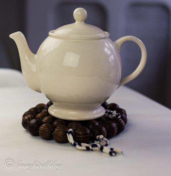 make a wooden beads tea trivet 5
