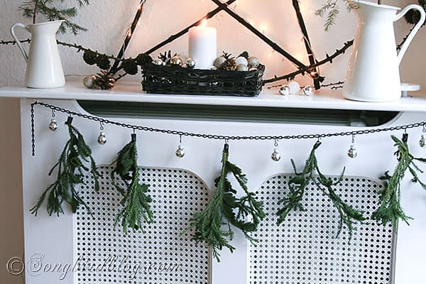 green pine branch Christmas garland on mantel