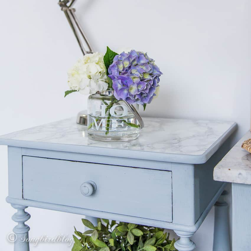 hydrangea blooms on grey nightstand
