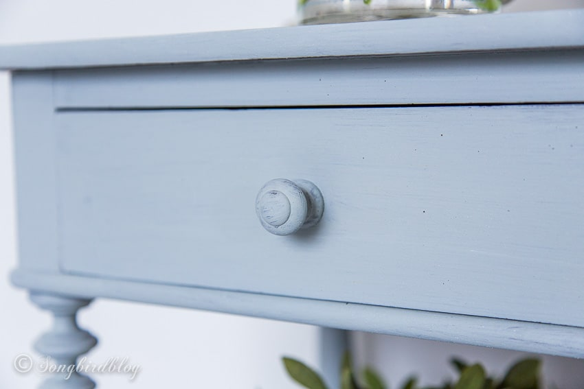 detail of night stand painted with milk paint